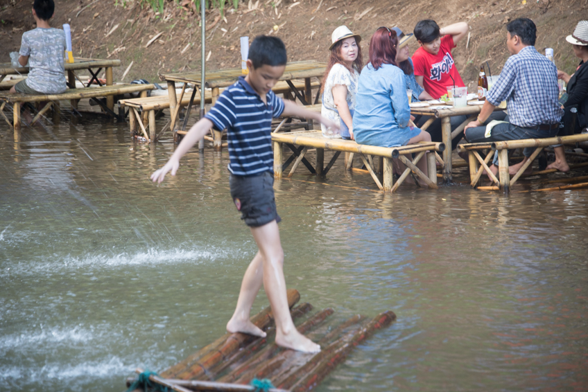 barefoot boy on raft
