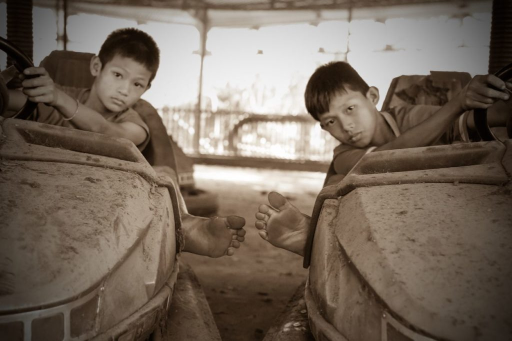 boys in bumper car