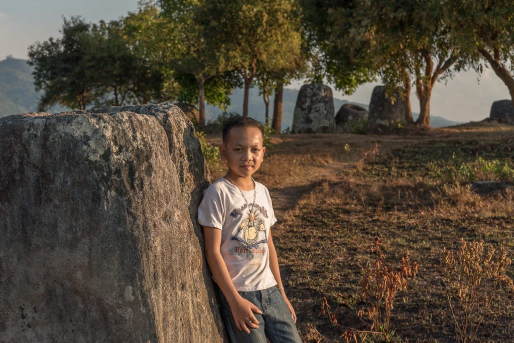 Plain of Jars with boy in photo