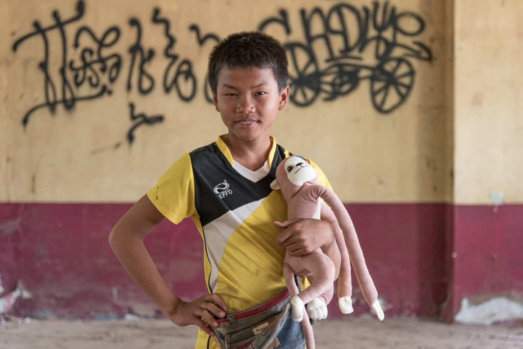 Boy in abandoned hotel Vientiane