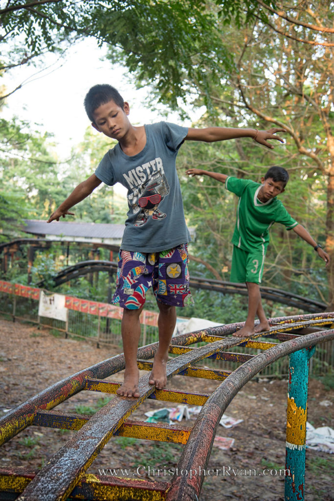 Burmese boys playing on roller coaster