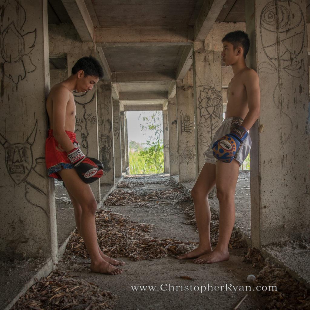 shirtless boys muay thai boxing