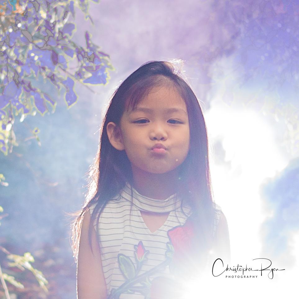 beautiful little girl with colored smoke