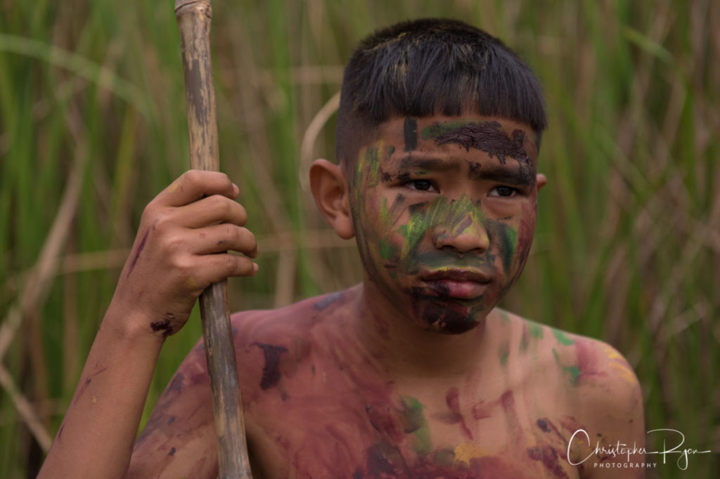 shirtless boy with angry face and facepaint