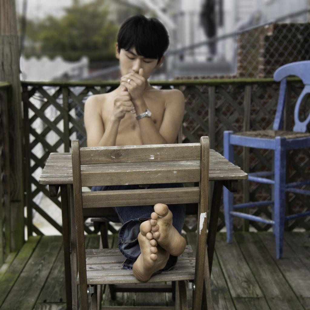soles of a beautiful shirtless boy's feet