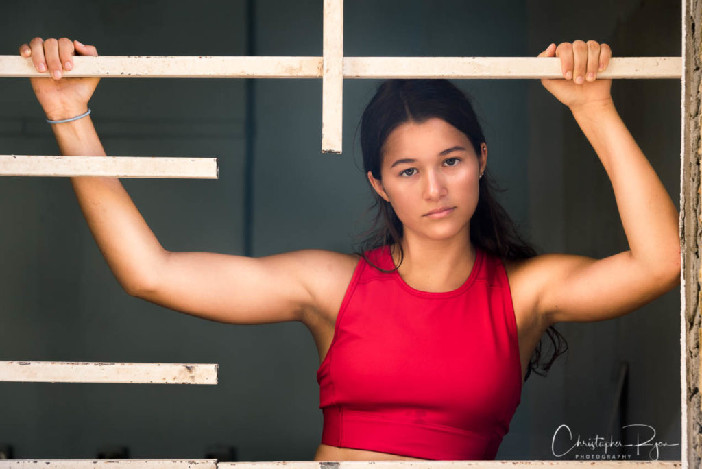 pauline cremer poses at an abandoned school in puerto rico