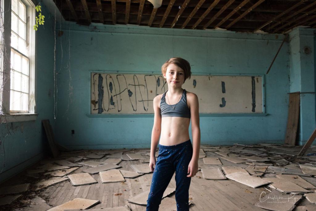 9 year old girl wearing sport bra in abandoned school