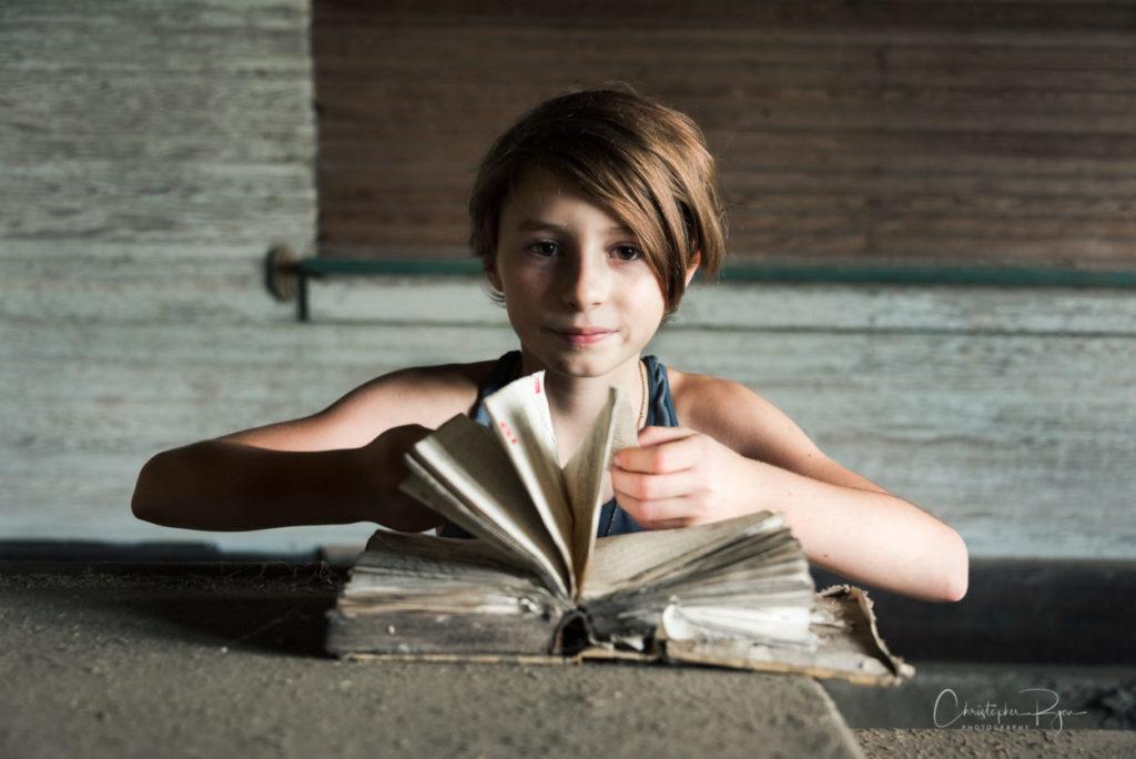 9 year old girl in abandoned school classroom