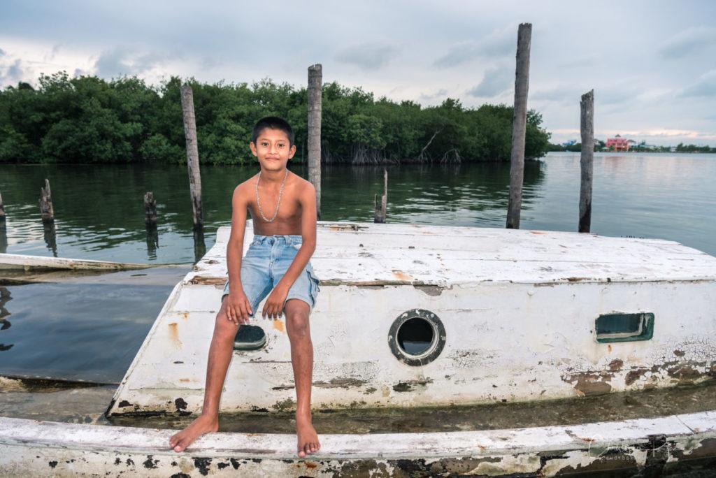 barefoot latino boy on a boat