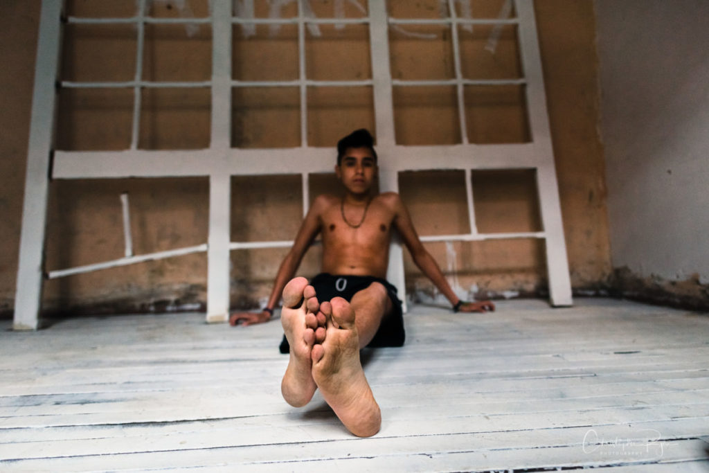 Barefoot and Shirtless Teen Colombian showing off his soles