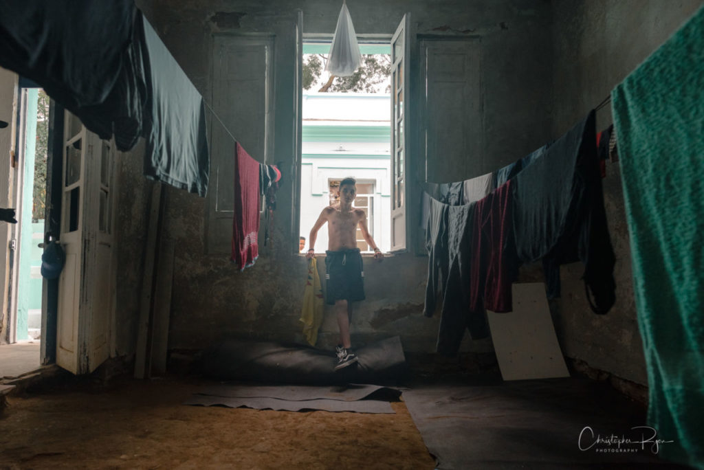 topless athletic teen shown in the center of laundry hung out to dry