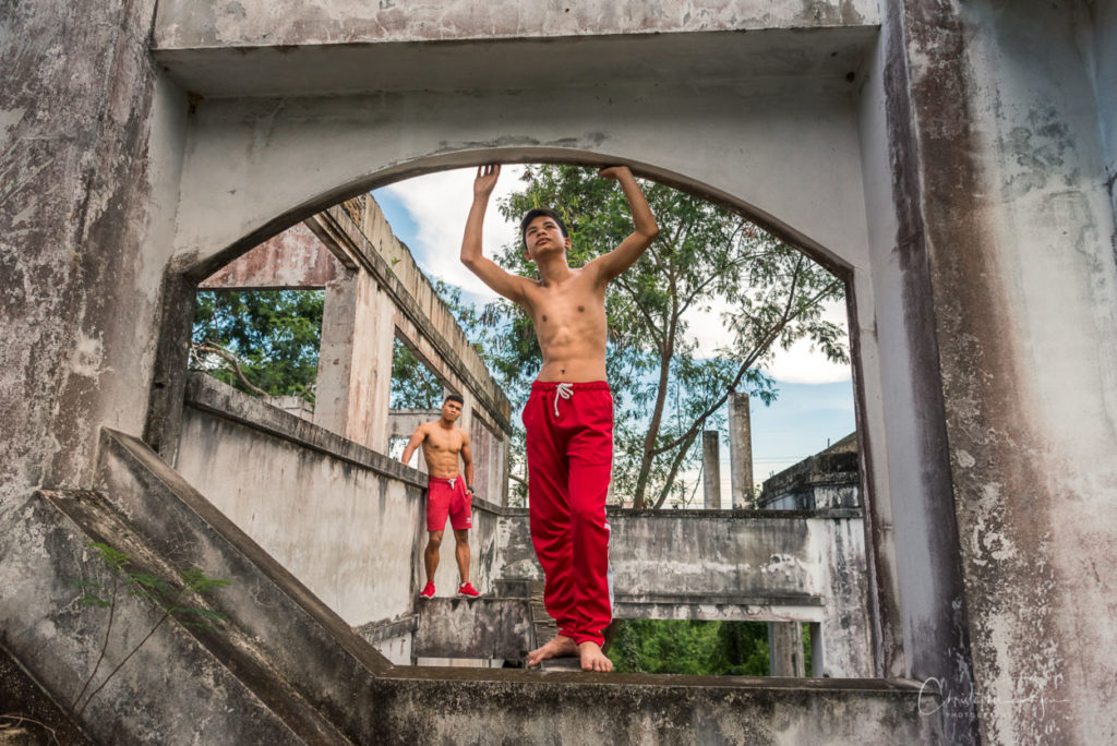 two shirtless guys in red sweats