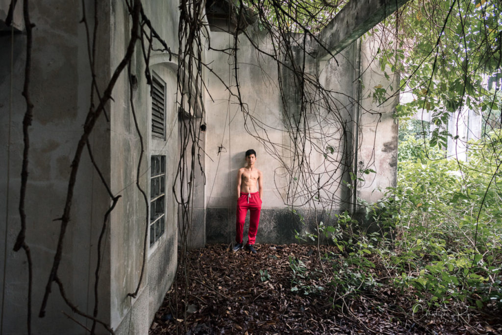 shirtless boy in abandoned building