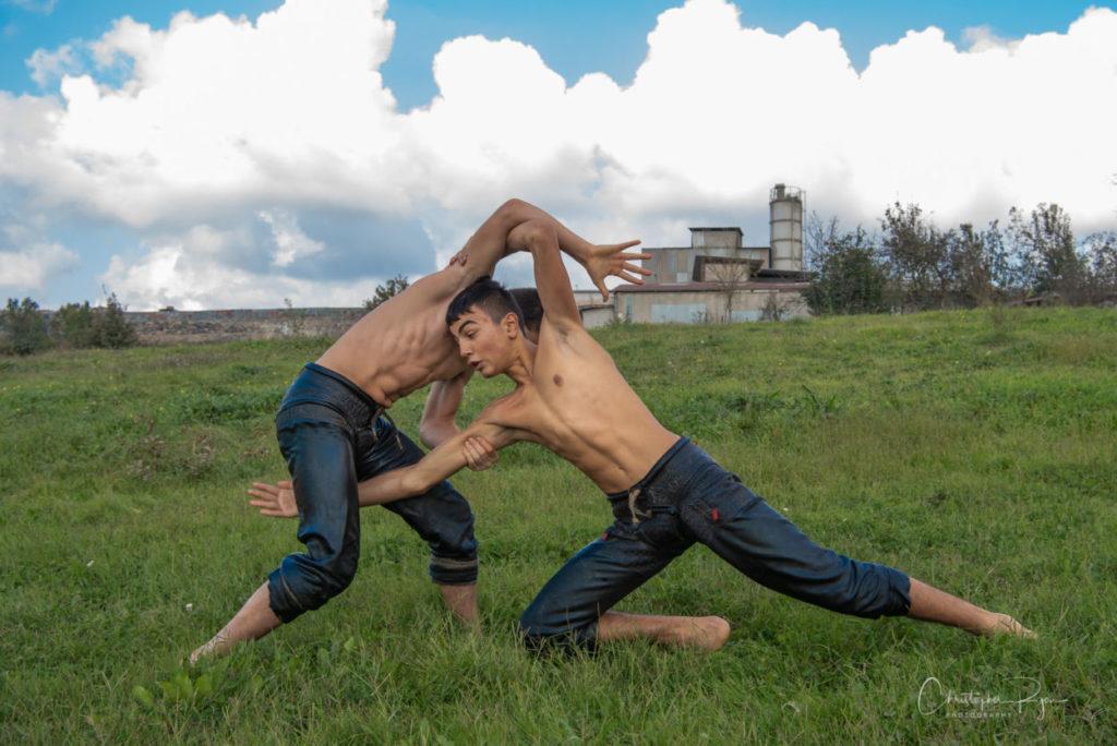 Teen boys oil wrestling in Turkey.