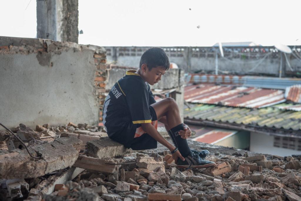 Teen boy football (soccer) player