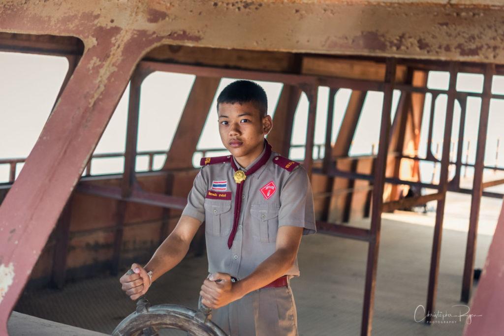 Handsome teenage boy in Thai Scout uniform.