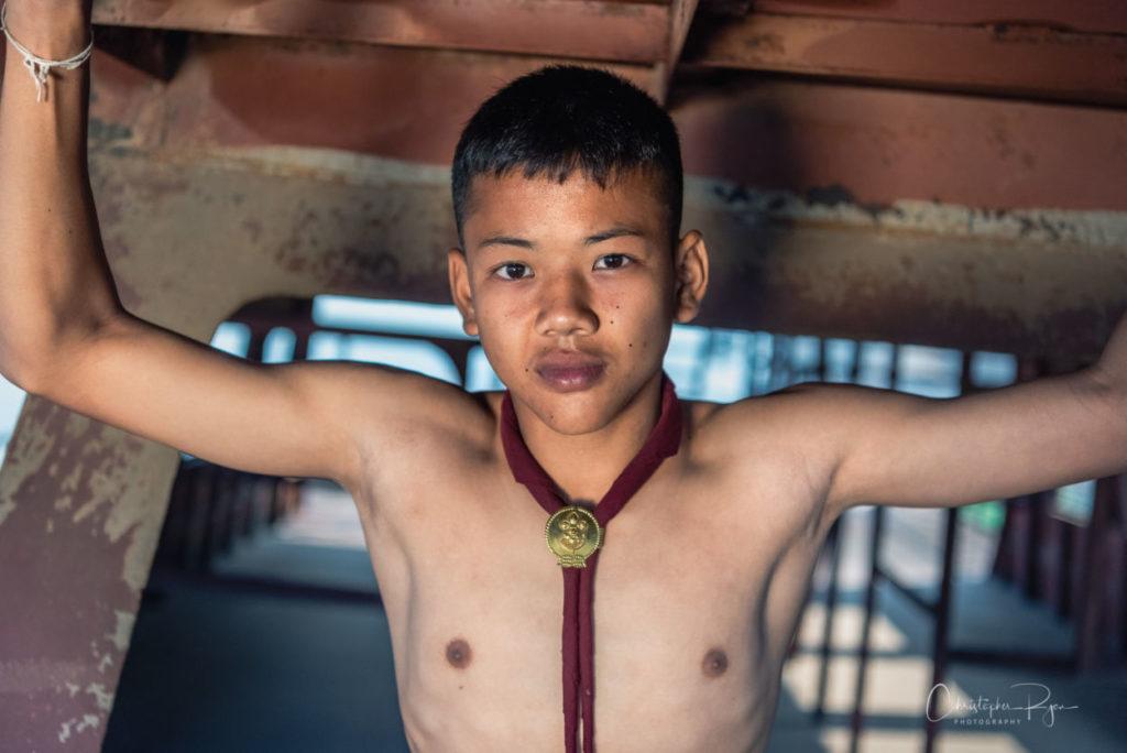 close up of shirtless thai teenager wearing onl a neckerchef
