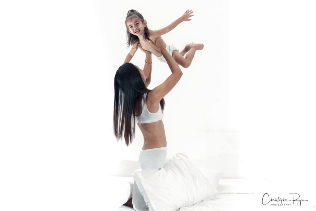 thai mother and toddler daughter in intimate setting