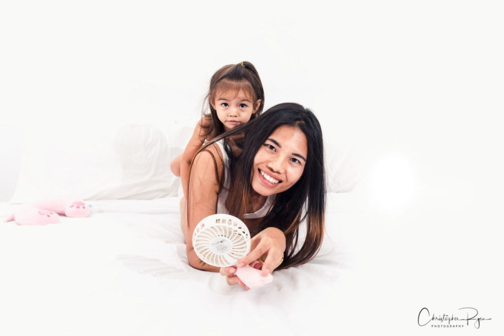 boudoir portrait session in hotel room with sexy thai lady and daughter