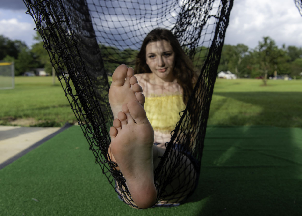 Teen girl showing off the soles of her feet