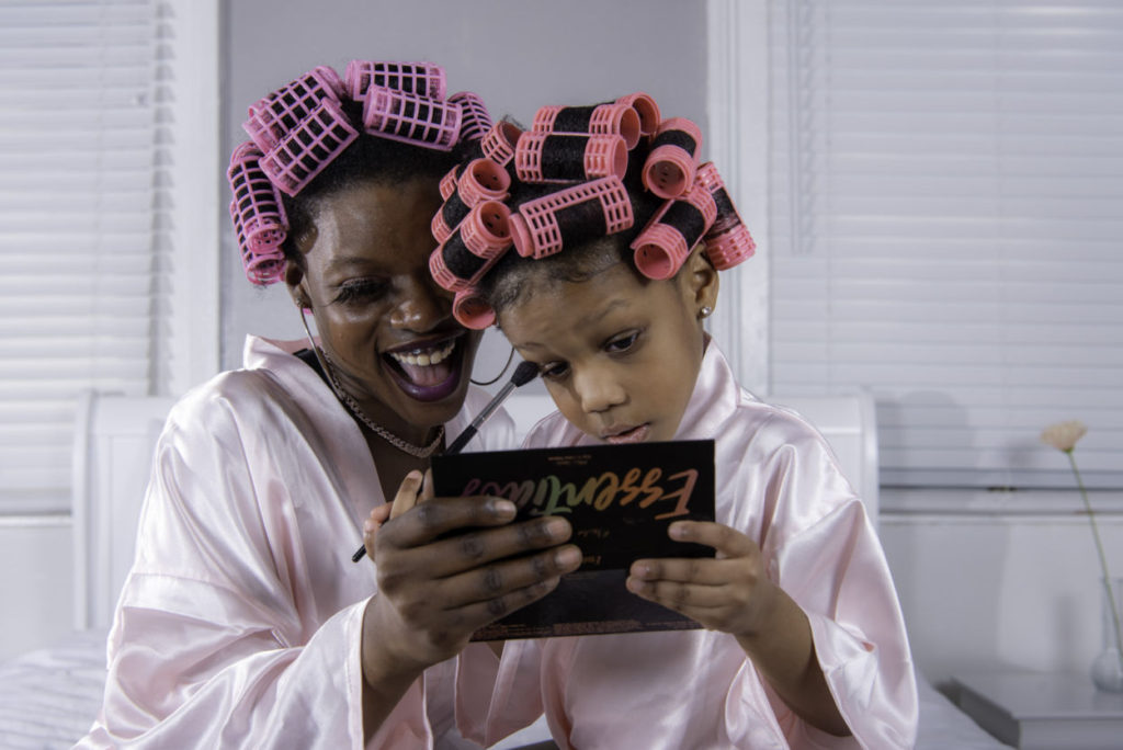 mom and daughter wearing pink robes