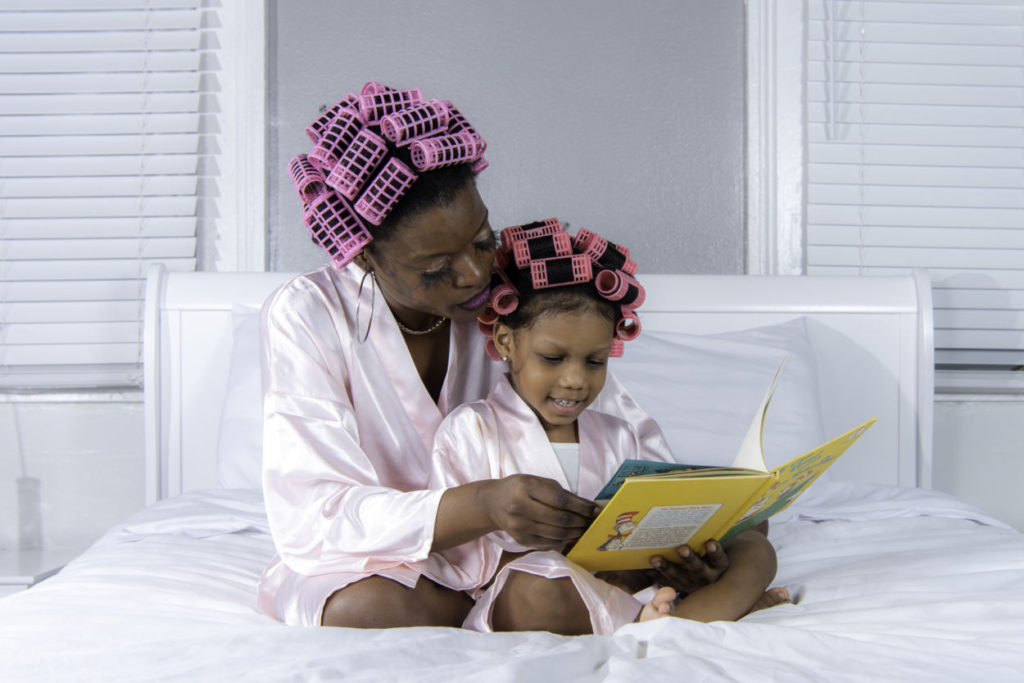 mom reading dr. seuss to her daughter